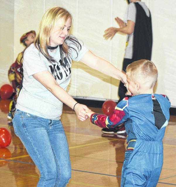 Sarah Anderson enjoys a dance with her son, Michael Jr. at the Mother Son Super Hero Party.
