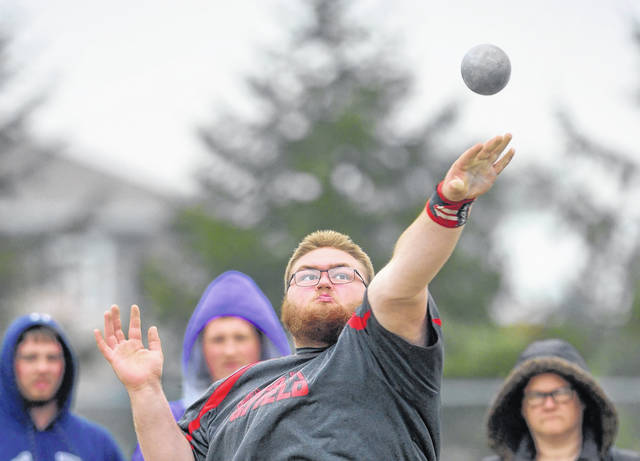 Columbus Grove's Hunter Roethlisberger competes in the shot put during Friday night's Putnam County League Meet at Ottoville High School.