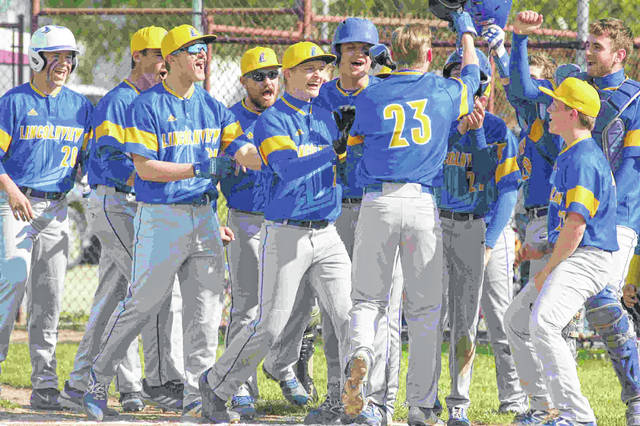 Lincolnview's Jaden Youtsey is greeted by his teammates after hitting a two-run home run in the first inning of Tuesday night's Northwest Conference game at Paulding.