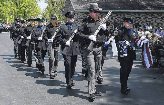 The local Fraternal Order of Police Honor Guard marches in to start the 2019 FOP Police Memorial service in Lima.