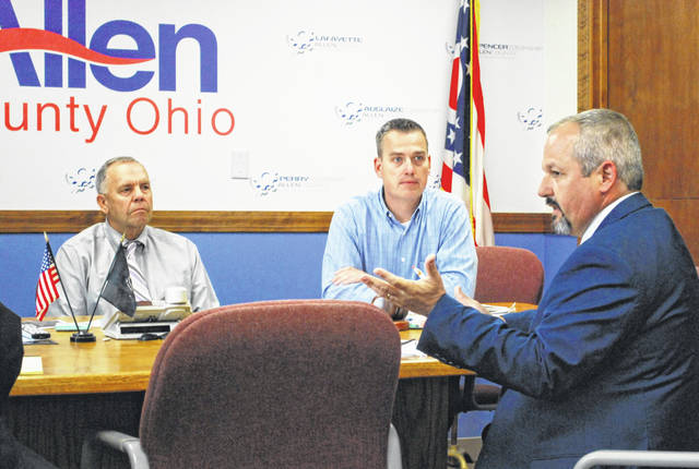 Tim Young, right, director of the office of the Ohio Public Defender, met with Allen County Commissioners on Tuesday to discuss potential changes in the way legal services are provided to indigent defendants in the county.