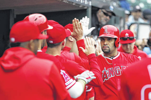 Albert Pujols of the Los Angeles Angels celebrates after hitting a solo home run in the third inning of a baseball game against the Detroit Tigers on Thursday for his 2,000th career RBI.