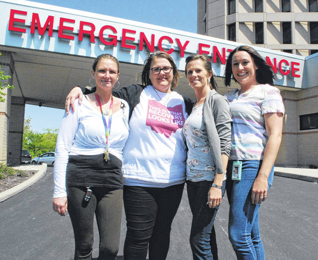 Sara Hollar, Lisa Ashafa, Abby Vorhees and Heather Ruble are pictured outside a place they know well: the emergency room at Mercy Health-St. Rita's Medical Center. The women volunteer their time to meet with overdose victims at five area hospital emergency rooms at part of a Quick Response Team, operated by Coleman Professional Services.