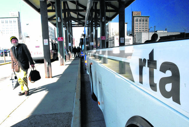 Passengers exit RTA buses at the station downtown in April.
