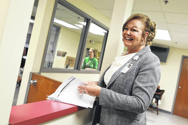 Allen County Regional Transit Authority Director Shelia Haney reacts positively after looking at election results for the sales tax increase Tuesday evening at the Allen County Board of Elections.