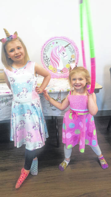 A birthday party with a theme mixed between unicorns and Tinkerbell led to two very happy daughters.