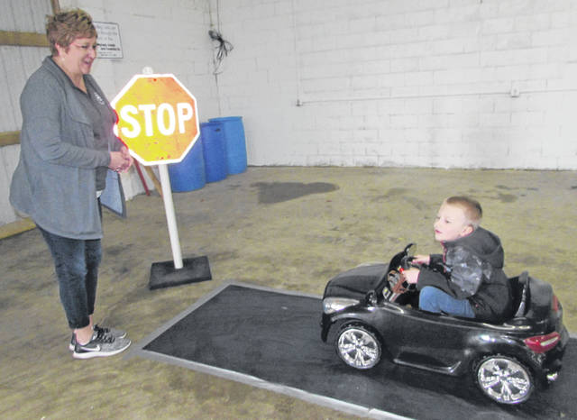 Joan Kline, Putnam County Health Department education coordinator, directs Joel Vennekotter, St. Anthony Catholic School kindergartener, during Putnam County's Safety City at the fairgrounds Wednesday.
