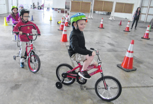 St. Anthony Catholic School students Jaxon Schroeder and Hudson Schroeder try their hand at a bicycle safety course Wednesday.