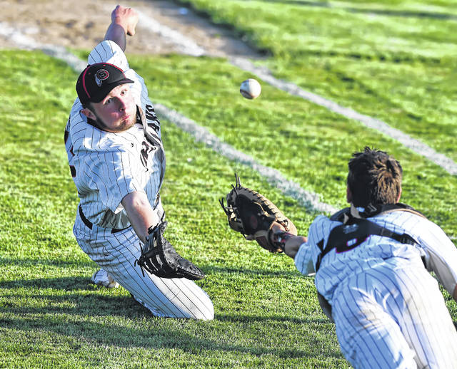Shawnee's Caden Vermillion, left, and Jacob Cowan dive for a bunt that drops between them during Thursday's Division II district semifinal against Clear Fork in Kenton. Richard Parrish | The Lima News