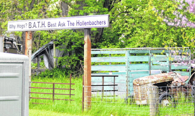 A sign on David Smith's property chastises former Bath Township Trustee Roy Hollenbacher.