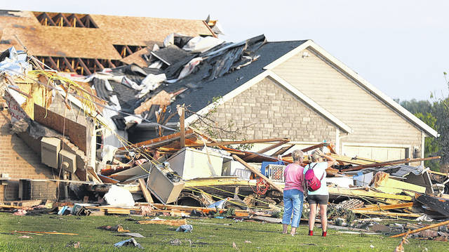 Homeowners in Wheatland Acres of Celina look at the damage done by the Tornado on Monday night. Levi A. Morman | The Lima News
