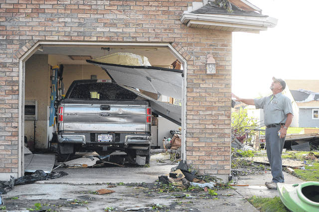 The sides of a garage were blown out of this home. Richard Parrish | The Lima News