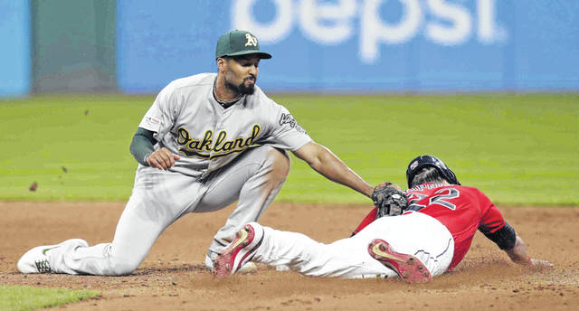 Cleveland Indians' Jason Kipnis, right, steals to second base as Oakland Athletics' Marcus Semien is late on the tag in the eighth inning of a baseball game, Monday, May 20, 2019, in Cleveland. (AP Photo/Tony Dejak)