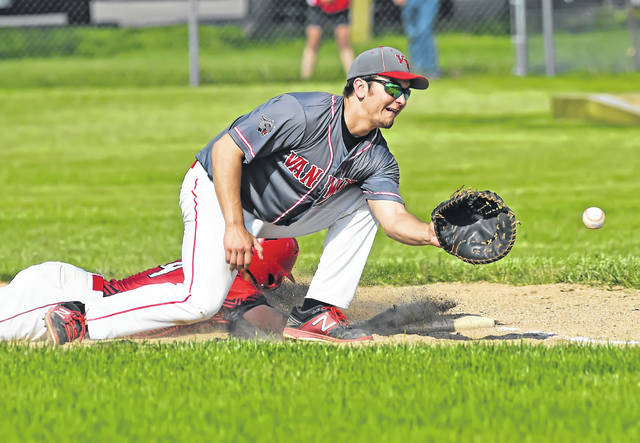 Wapakoneta's Isaac Webb gets back to the base as Van Wert's Nathan Temple receives the throw during Saturday's Division II sectional final at Smiley Park in Van Wert.