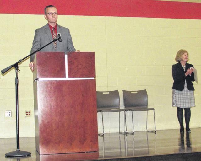 From left are Tony Unverferth, Vantage Career Center high school director, and LuAnne Cooke, Lt. Governor Jon Husted's aide.