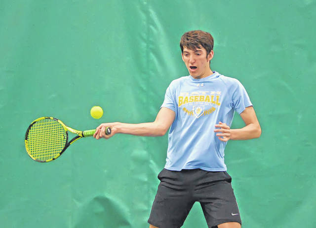 Bath's Jacob Garver returns a shot to Celina's Logan Goettemoeller during a Thursday WBL Tournament match at Westwood Tennis and Fitness Center.