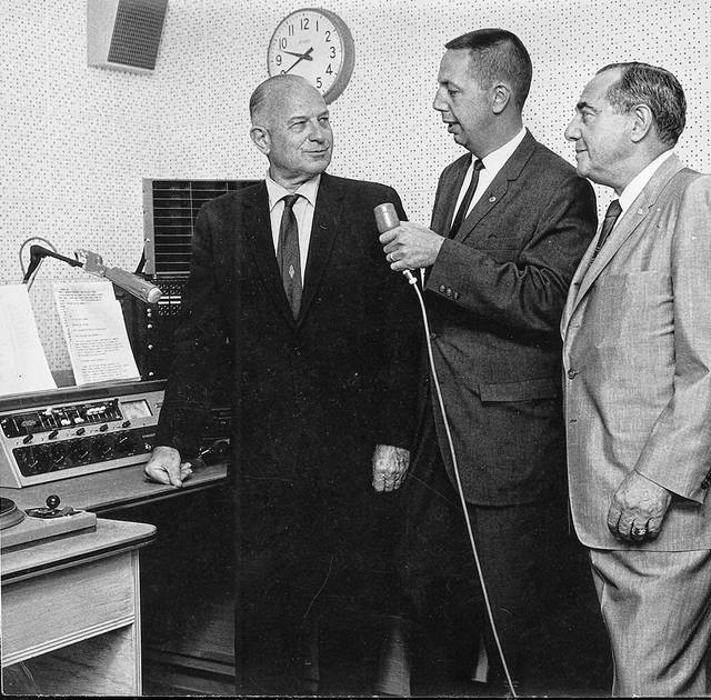 WCIT co-owners James Howenstine, left, and Sam Kamin, right, stand by to go on the air in special dedication ceremonies Aug 22, 1963, as manager James Lusk holds the mike. SCIT began broadcasting at 615 a.m., climaxing a five-year fight by the owners to get FCC approval.