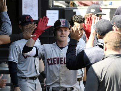 Cleveland's Jake Bauers is congratulated in the dugout after hitting a home run against the Chicago White Sox during the fifth inning of Tuesday's game in Chicago. (AP photo)