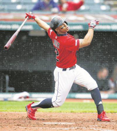 The Indians' Francisco Lindor hits a double during Thursday's game against the Chicago White Sox in Cleveland.
