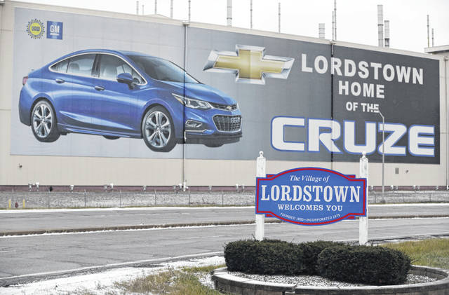 This Nov. 27, 2018 file photo shows a mural at General Motors' plant in Lordstown, Ohio. A potential deal to sell the shuttered General Motors plant in Ohio is still leaving the factory with an uncertain future. In May 2019, GM confirmed that it's negotiating the sale of the massive assembly plant. (AP Photo/Tony Dejak, File)