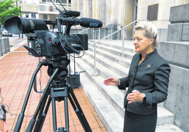Karen C. Lefton, an Akron, Ohio attorney representing the Washington Post, talks to reporters outside the Potter Stewart Federal Courthouse, Thursday May 2, 2019, in Cincinnati. Lefton argued before a three-judge panel of the 6th U.S. Circuit Court of Appeals that federal data about how prescription opioid drugs were distributed should be made public. Federal attorneys say released the data could compromise Drug Enforcement Administration investigations.