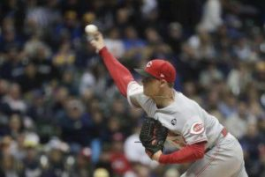 Reds strike out 14, beat short-handed Brewers 3-0