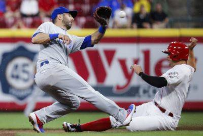 The Reds' Nick Senze reaches second base safely to record a steal against the Chicago Cubs' Daniel Descalso during Thursday night's game in Cincinnati. (AP photo)