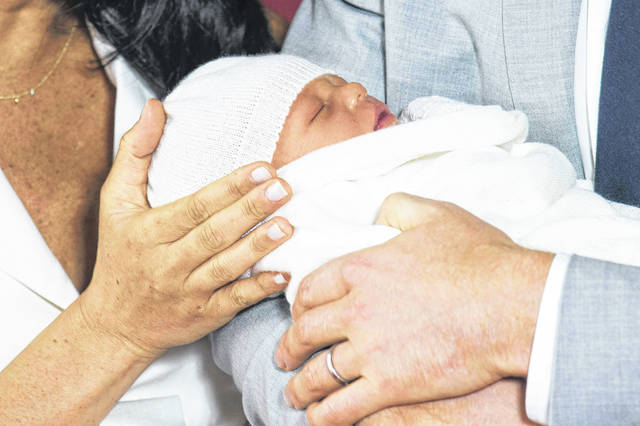 """An overjoyed Prince Harry said he and Meghan are """"thinking"""" about names for their newborn baby.(Dominic Lipinski/Pool via AP)"""
