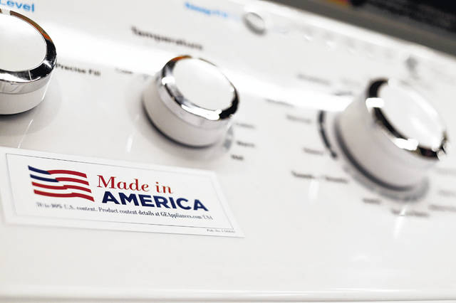 A General Electric washing machine carries a label advertising it was made in America. China has announced tariff hikes on $60 billion of U.S. goods in retaliation for President Donald Trump's escalation of a fight over technology and other trade disputes. (AP Photo/Keith Srakocic)