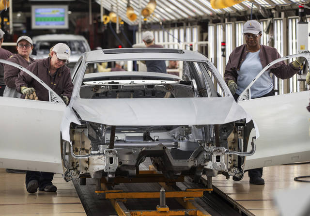 FILE - In this Aug. 31, 2017, file photo, workers produce vehicles at Volkswagen's U.S. plant in Chattanooga, Tenn. Top Tennessee Republicans are predicting economic harm if a vote to unionize Volkswagen's car assembly plant in Chattanooga passes. (AP Photo/Erik Schelzig, File)