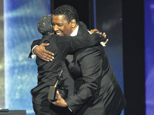 Actor Denzel Washington, right, is embraced by filmmaker Spike Lee as he receives the 47th AFI Life Achievement Award during a ceremony at the Dolby Theatre on Thursday in Los Angeles.