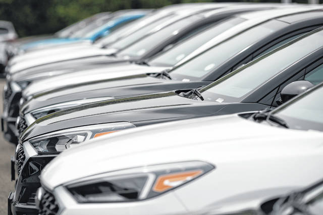 A line of unsold 2019 Tucson sports-utility vehicles sits at a Hyundai dealership in Littleton, Colo., in May. With the cost to own a new vehicle rising, it's more important than ever to consider what you'll pay for a car loan and to shop for the best interest rate.