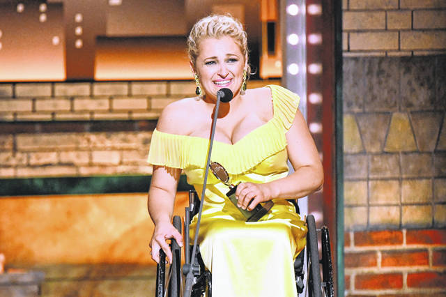 """Ali Stroker accepts the award for best performance by an actress in a featured role in a musical for """"Rodgers & Hammerstein's Oklahoma!""""at the 73rd annual Tony Awards at Radio City Music Hall on Sunday in New York."""