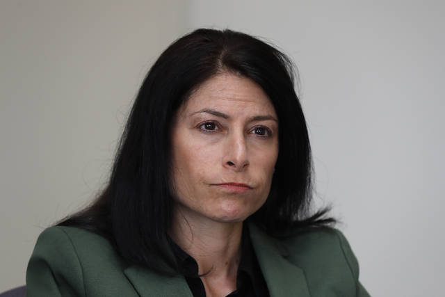 "In this June 4, 2019, photo, Dana Nessel, Attorney General of Michigan, listens to a question from reporters in Detroit. Hundreds of boxes. Millions of records. From Texas to Michigan this month, attorneys general are sifting through ""secret"" files, nondisclosure agreements between the church and families, heart wrenching letters from parents begging for action, priests' own psychiatric evaluations. They're looking to prosecute, and not just priests. (AP Photo/Paul Sancya)"