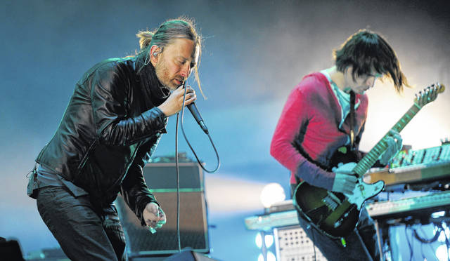 Thom Yorke, left, and Jonny Greenwood of Radiohead perform during the band's headlining set at the 2012 Coachella Valley Music and Arts Festival in Indio, Calif. Radiohead says a trove of unreleased music has been stolen and is being used for ransom. Instead of paying up, the band announced Tuesday it will release it in aid of environmental activist group Extinction Rebellion.