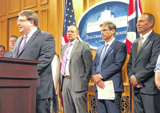 Ohio Senate President Larry Obhof discusses the latest state budget proposal as fellow Senate Republicans listen during a news conference Tuesday at the Statehouse in Columbus.