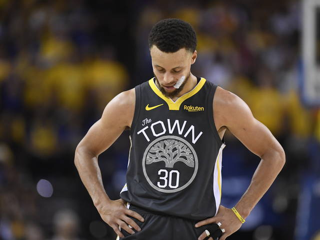 Golden State Warriors guard Stephen Curry looks down during the second half against the Toronto Raptors in Game 6 of basketball's NBA Finals, Thursday, June 13, 2019, in Oakland, Calif. (Frank Gunn/The Canadian Press via AP)