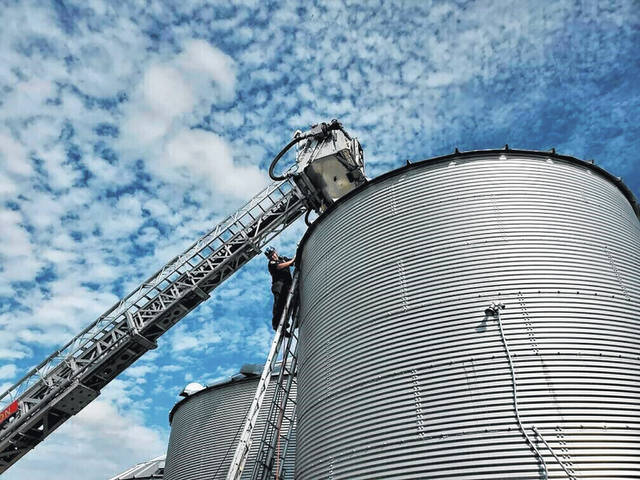 A fire truck bucket hovers over a bin May 30 where farmer Jay Butterfield became buried up to his neck in soybeans. The successful rescue effort involved 52 rescue personnel from a dozen agencies.