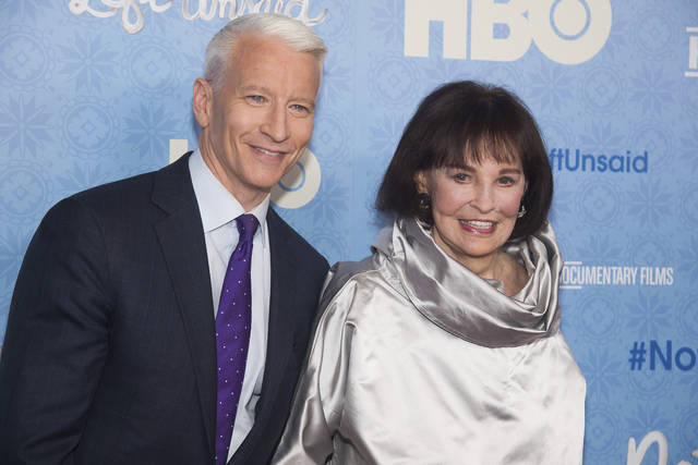 "CNN anchor Anderson Cooper and Gloria Vanderbilt attend the premiere of ""Nothing Left Unsaid"" in April 2016 at the Time Warner Center in New York. Vanderbilt, the ""poor little rich girl"" heiress at the center of a scandalous custody battle of the 1930s and the designer jeans queen of the 1970s and '80s, died Monday at 95, according to her son, Cooper."