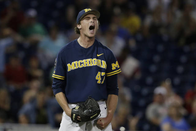 Michigan pitcher Tommy Henry (47) reacts after pitching a complete game against Florida State in an NCAA College World Series baseball game in Omaha, Neb., Monday, June 17, 2019. (AP Photo/Nati Harnik)
