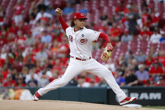 Cincinnati Reds starting pitcher Luis Castillo throws in the first inning of a baseball game against the Houston Astros, Monday in Cincinnati.