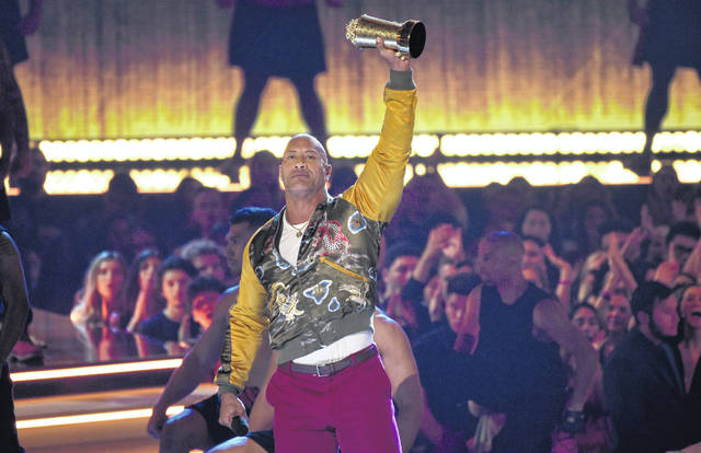 Dwayne Johnson, also known as The Rock, accepts the generation award at the MTV Movie and TV Awards on Saturday at the Barker Hangar in Santa Monica, Calif.