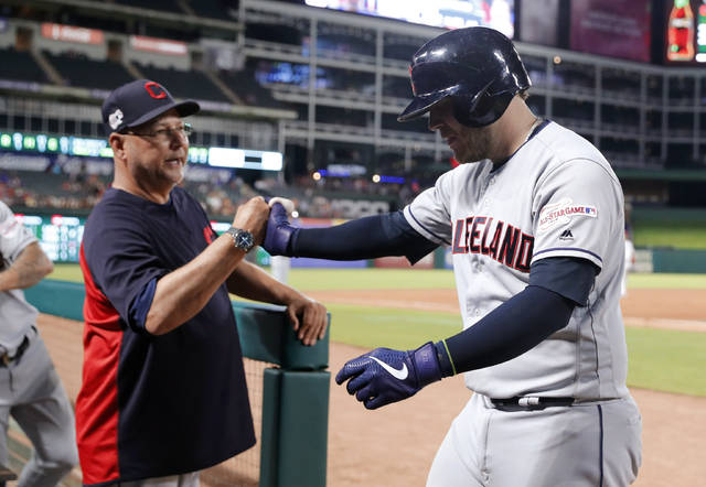 Cleveland Indians manager Terry Francona congratulates Roberto Perez, right, after Perez hit a solo home run off Texas Rangers' Drew Smyly during the seventh inning of a baseball game in Arlington, Texas, Tuesday, June 18, 2019. (AP Photo/Tony Gutierrez)