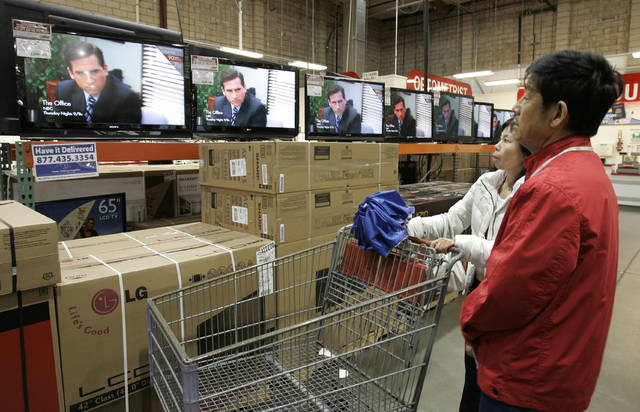 "In this Feb. 22, 2009, file photo, shoppers watch the television show ""The Office"" as they compare wide screens on display at Costco in Mountain View, Calif. Netflix announced that NBC's hit show ""The Office"" will be pulled from its lineup after 2020 and head to NBCUniversal's upcoming service."