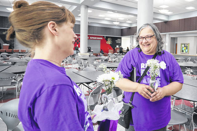 Breast cancer survivors Amy Wahlgren (left) of Lima and Lisa Williams of Lima attend the Silver Linings Survivor Dinner held at the Lima Senior High School on Friday evening.