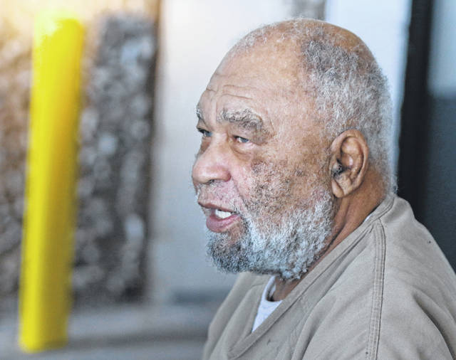 FILE - In this Monday, Nov. 26, 2018 file photo, Samuel Little, who often went by the name Samuel McDowell, leaves the Ector County Courthouse after attending a pre-trial hearing in Odessa, Texas. Little, who has confessed to killing more than 90 women across the U.S. has been indicted in Cleveland for the strangulation deaths of two women decades ago. Cuyahoga County Prosecutor Michael O'Malley on Friday, May 31, 2019 said 78-year-old Samuel Little confessed to killing 21-year-old Mary Jo Peyton in 1984 and 32-year-old Rose Evans in 1991.