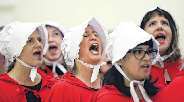 """FILE - In this Tuesday, May 23, 2017 file photo, activists dressed as characters from """"The Handmaid's Tale"""" chant in the Texas Capitol Rotunda as they protest. Tissue left over from elective abortions has been used in scientific research for decades, and is credited with leading to lifesaving vaccines and other advances."""