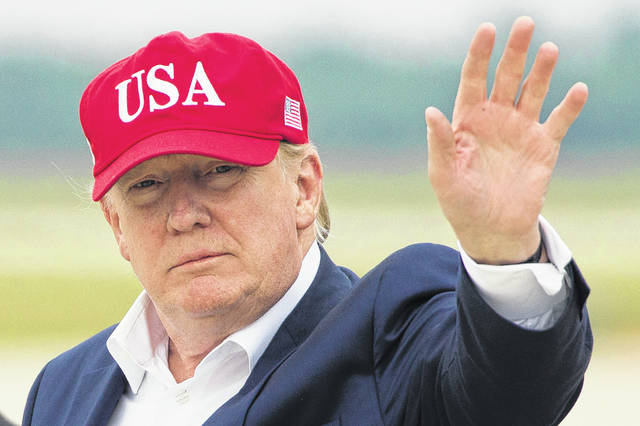 President Donald Trump waves as he steps off Air Force One after arriving, Friday, June 7, 2019, at Andrews Air Force Base, Md.