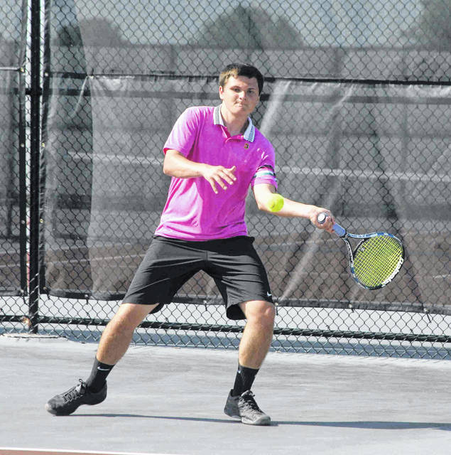 Brandon Amstutz prepares to fire one over the net Saturday during the second day of competition at the Lima Area Tennis Association's City Singles tennis tournament at UNOH.