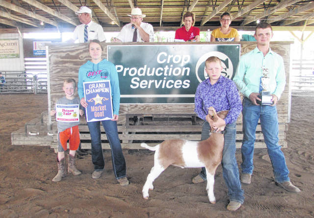 From left participating in the small animal livestock sale at the Putnam County Fair Thursday are Trevor, Sydney and Cole Kleman, and Logan Warnecke and Cole's goat.